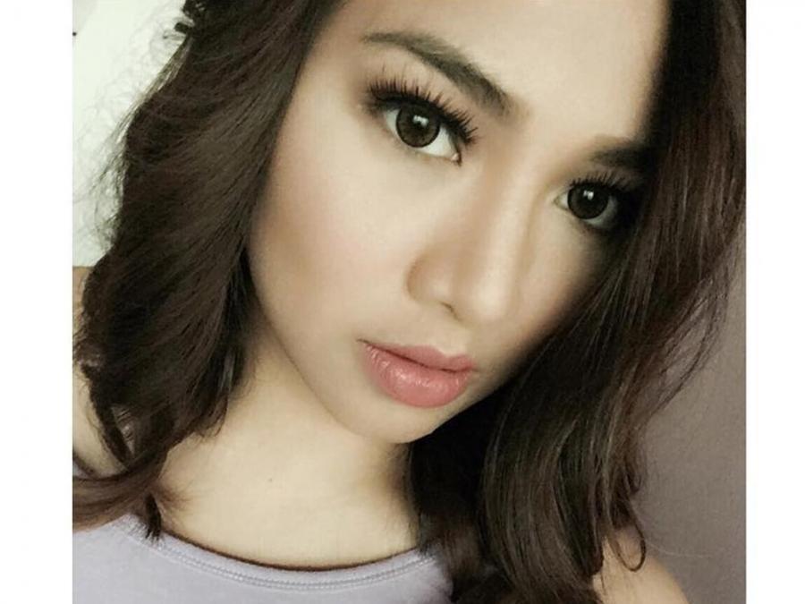 Born Marie Tan  lSZhQAI4