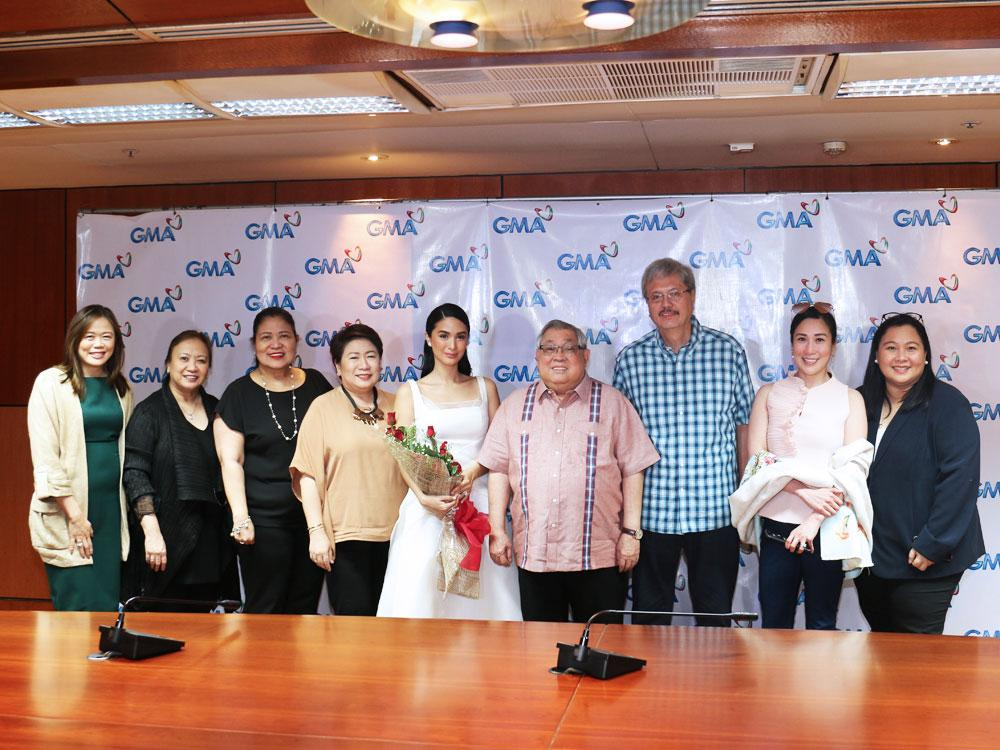 From left: GMA Senior Assistant Vice President for Alternative Productions Gigi Santiago-Lara, GMA Vice President for Business Development Department III Darling de Jesus Bodegon, GMA Vice President for Drama Productions Redgie Acuña-Magno, GMA Senior Vice President for Entertainment Group Lilybeth G. Rasonable, Heart Evangelista, GMA Chairman and Chief Executive Officer Atty. Felipe L. Gozon, GMA Executive Vice President and Chief Financial Officer Felipe S. Yalong, GMA Films President Annette Gozon, and GMA Vice President for Corporate Affairs and Communications Angel Javier Cruz.
