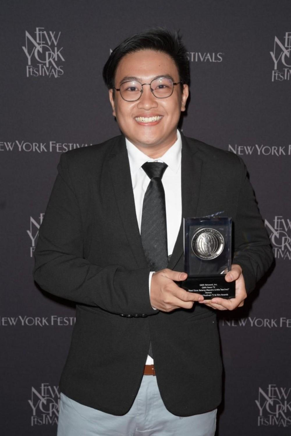 "The ""Batang Maestro"" episode of GMA News TV's Reel Time won a Silver World Medal in the Heroes category. Receiving the award for Reel Time was Executive Producer and writer Mark Norella."