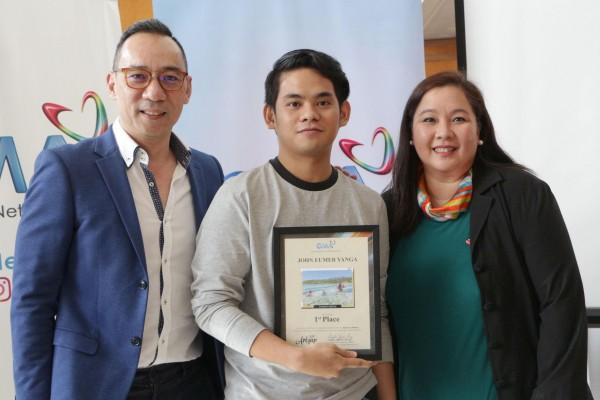 (L-R) GMA First Vice President for Post Production Paul Ticzon, Art Gap's first placer John Eumer Yanga, and Vice President for Corporate Affairs and Communications Angel Javier Cruz